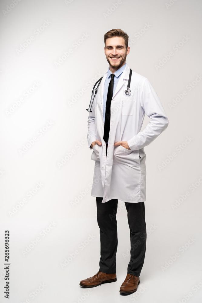 Fototapeta Full length young medical doctor on white background.