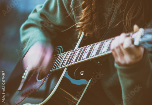 Close up woman's hands playing acoustic guitar with the sensation of hand movement - 265701587