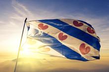Friesland Province Of Netherlands Flag Waving On The Top Sunrise Mist Fog