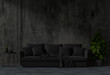 Leinwanddruck Bild - living room concrete wall with black sofa in darkness at night in a home interior. 3d Rendering