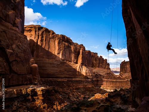 Free-hanging Rappel into Arches National Park canyon in Southern Utah desert Wallpaper Mural