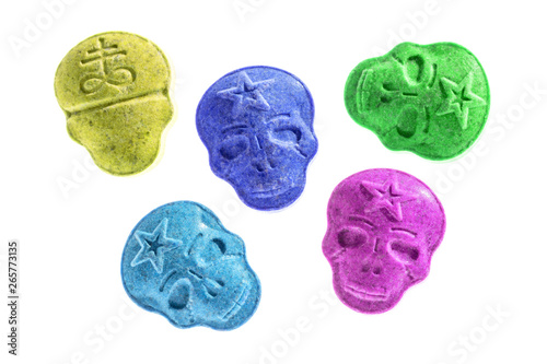 Party drugs: many coloured Amphetamine, Army Skull, Ecstasy, XTC pills isolated on a white background Canvas Print