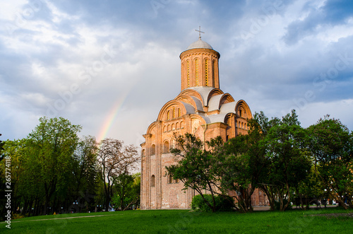 Poster de jardin Con. Antique Temple of the Holy Mother Paraskevki Friday at the Torgovo Chernigov on the background of a blue, light rain with a rainbow sky. Ukraine
