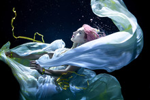 Woman With Pink Hair In White Dress Underwater. Mermaid, Nymph Or Drowning In White Dress Under Water