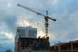 cityscape high-rise tower crane at home construction