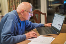 Elderly Person Using A Laptop ...