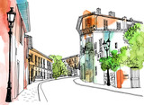 Fototapeta Uliczki - Old town street in hand drawn sketch style. Provence, France, Vector illustration. Small European city. Urban landscape on watercolor colorful background