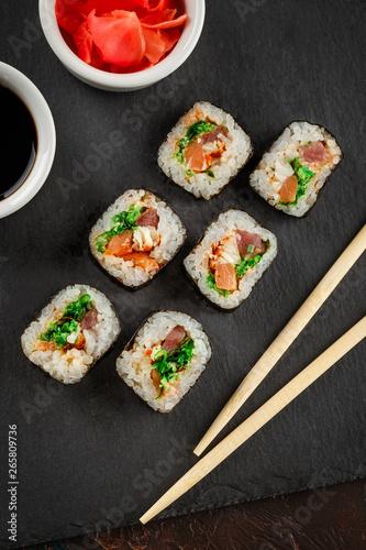 Autocollant pour porte Sushi bar Japanese sushi on a rustic dark background.