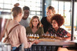 canvas print picture - Waitress Serving Group Of Friends Beer Tasting In Bar