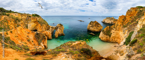 View of stunning beach with golden color rocks in Alvor town , Algarve, Portugal Canvas-taulu