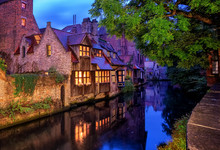 Bruges Old Town, Belgium. Traditional Medieval Houses At Night.