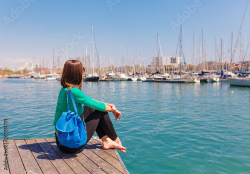 Tourist woman in the port of Barcelona, Catalonia, Spain