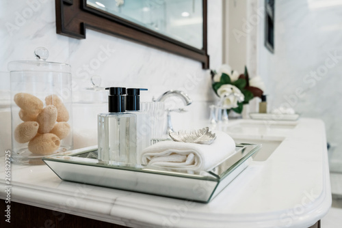 beautiful amenity hotel set on white marble counter in bathroomm Canvas Print