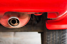 Selective Focus Of Close Up Exhaust Pipe Of The Red Car