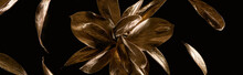 Panoramic Shot Of Golden Metal Decorative Flower And Leaves Isolated On Black