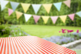 Fototapeta Coffie - Summer background of tablecloth and garden of summer time