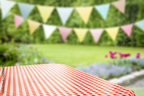 Summer background of tablecloth and garden of summer time
