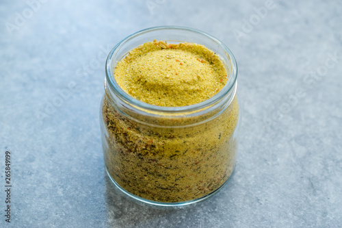 Photo  Vegeta Seasoning Spices Condiment with Dehydrated Carrot Parsley Celery Parsnips and Salt with or without Glutamate in Jar / Glass Bowl
