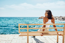 Woman Taking A Break In Front Of The Sea During Summer Vacation.