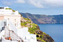 Traditional Whitewashed Houses And Aegean Sea In Oia With View Of Caldera And Aegean Sea. Santorini, Greece