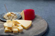 Blocks Of Dutch Red Ball Edam Cheese And Mustard