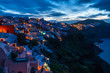 Santorini landscape with view of whitewashed houses in Oia at sunrise, Greece