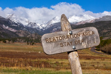 Restoration Area Sign On National Park Government Protected Lands, Federal Land, Mountain And Field Landscape