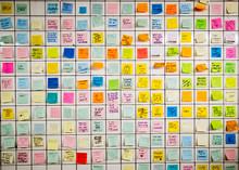 Many Sticky Notes On A Tile Wall