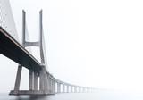 Ponte Vasco da Gama, Lisbon on a misty morning in March. Large concrete bridge across River Tagus, Portugal