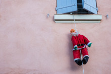 Santa Clause Figure Hanging On...