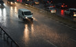 Leinwanddruck Bild - delivery van speeding by highway in rainy night
