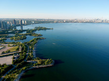 Aerial Bird Eye Shot Over Humber Bay Shores Park, Toronto, Canada With Coastal Condo Homes, Blue Skies, Beaches And Harbour Entrance In View With Glass Condominiums. Perfect Summer Day Sunset.
