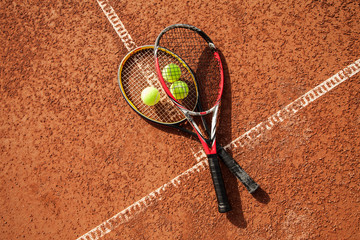 Tennis ball with racket on court