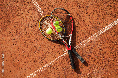 obraz lub plakat Tennis ball with racket on court