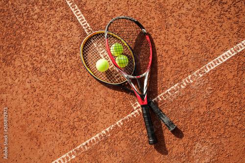 fototapeta na ścianę Tennis ball with racket on court