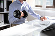Leinwandbild Motiv Young Businessman Exercising With Dumbbells In Office