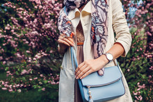 Young Woman Holding Stylish Handbag And Wearing Trendy Outfit. Spring Female Clothes And Accessories. Fashion