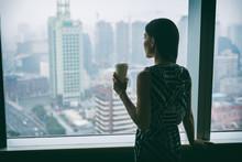 Businesswoman Drinking Coffee ...