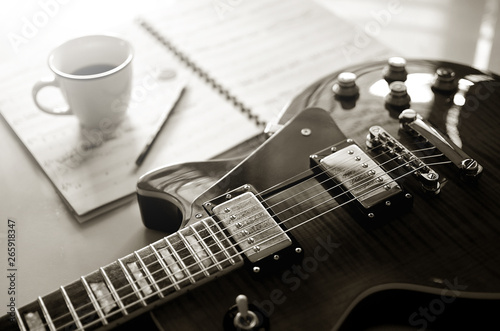Electric guitar and  a cup of coffee on  background Canvas Print