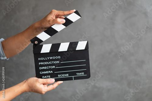 Cuadros en Lienzo Women hands holding clapper board for making video cinema in studio