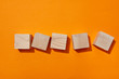 canvas print picture - top view of wooden blocks on orange surface