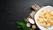 Dumplings with potatoes and bacon. Ukrainian Traditional Cuisine. Top view. Free space for your text. Rustic style.