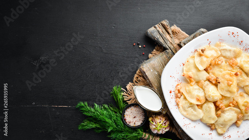 Fototapety, obrazy: Dumplings with potatoes and bacon. Ukrainian Traditional Cuisine. Top view. Free space for your text. Rustic style.