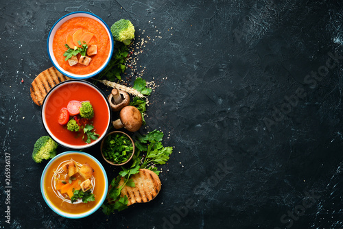 Valokuvatapetti Assortment of colored vegetable cream soups