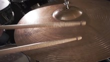 Drummer Hitting On Wet Drum Cymbal