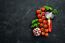 Fresh Cherry Tomatoes On A Twig. Vegetables. Top View. Free Space For Your Text. On A Wooden Background.