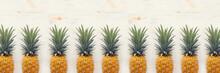 Banner Of Ripe Pineapple Over White Wooden Background. Beach And Tropical Theme. Top View