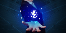Hand In Suit Holding Lightning...