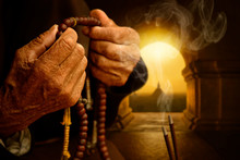 Hands With Buddhist Prayer Beads