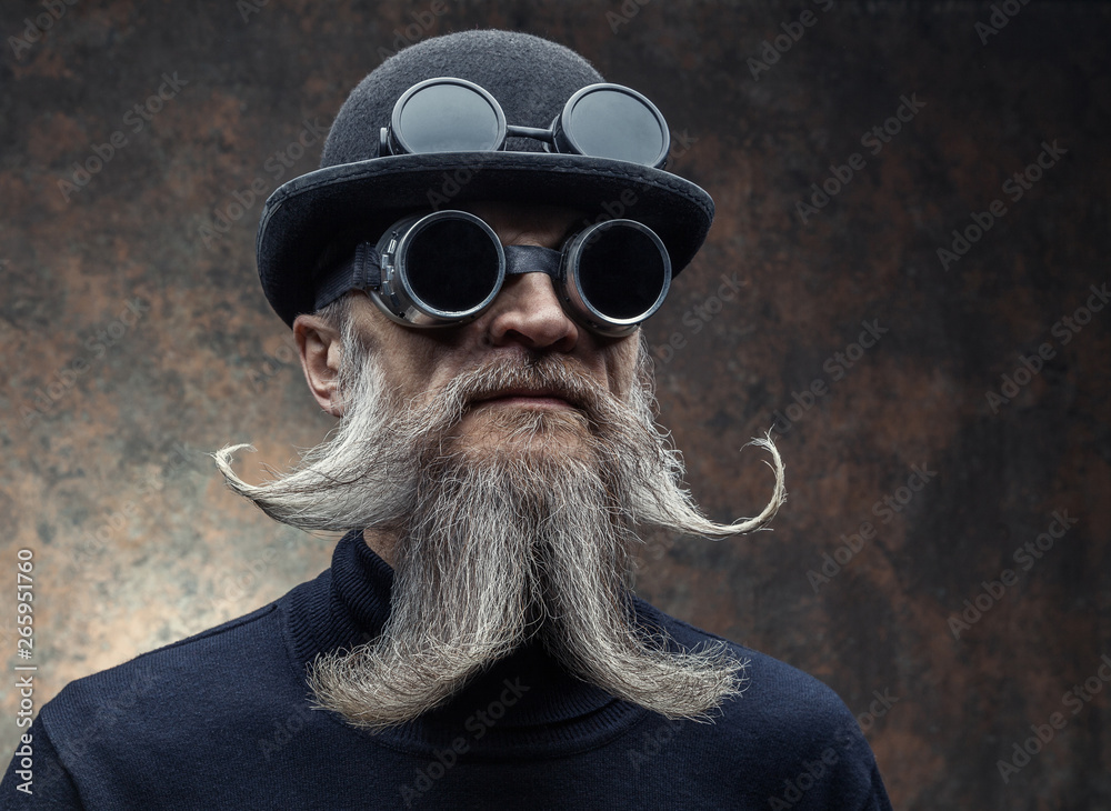 Fototapeta Portrait of a bearded man in with sunglasses